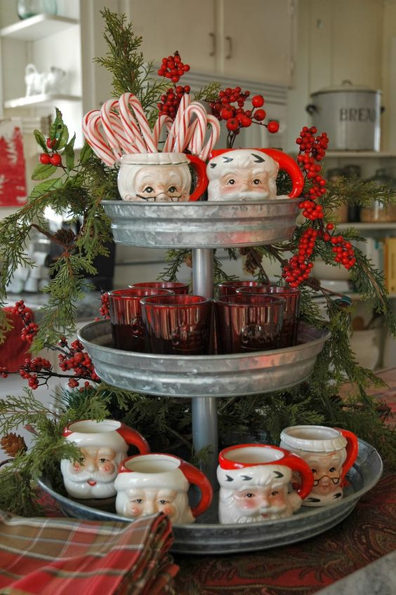vintage Santa mugs on a galvanized cupcake stand