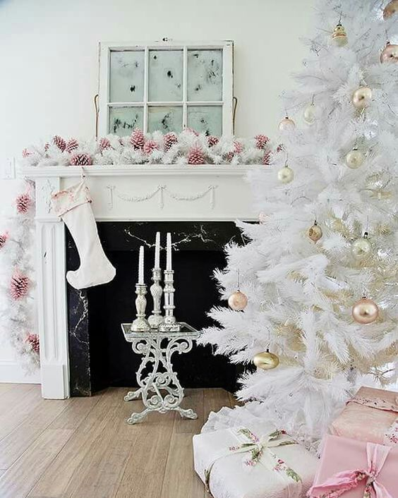 shabby chic living room with pink pinecones, white evergreens and gold ornaments