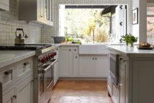 37 red large hex tiles on the floor in a light-colored kitchen