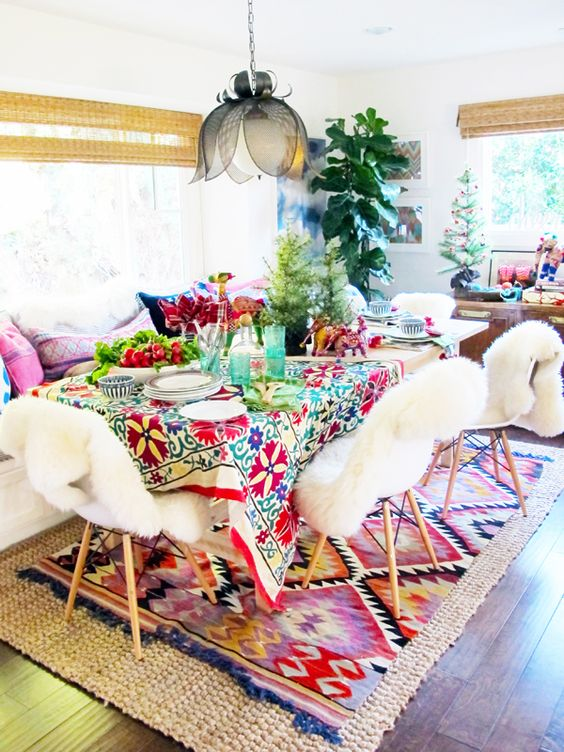 colorful boho table setting, a flower pendant lamp and a pattern blanket