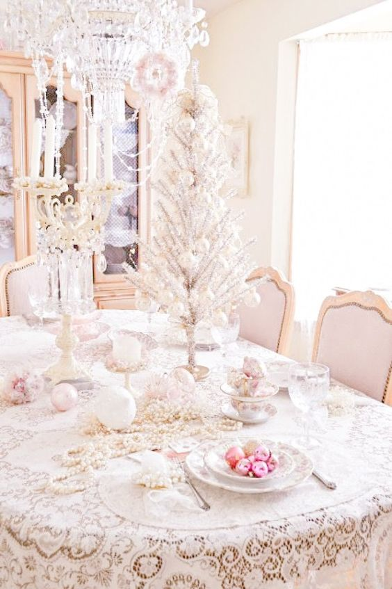 shabby chic table setting with a silver tabletop tree, pastel ornaments and beads