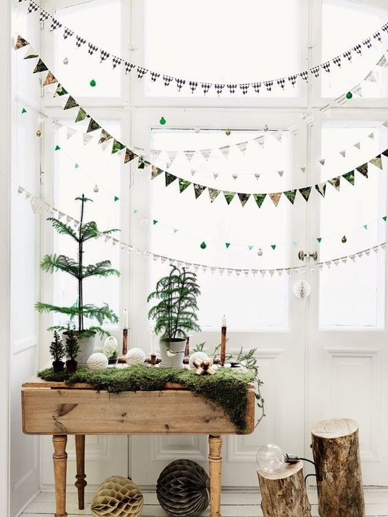colorful fabric garlands on the window and fresh greenery