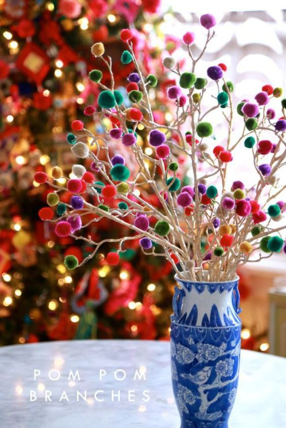 white branches with colorful pompoms