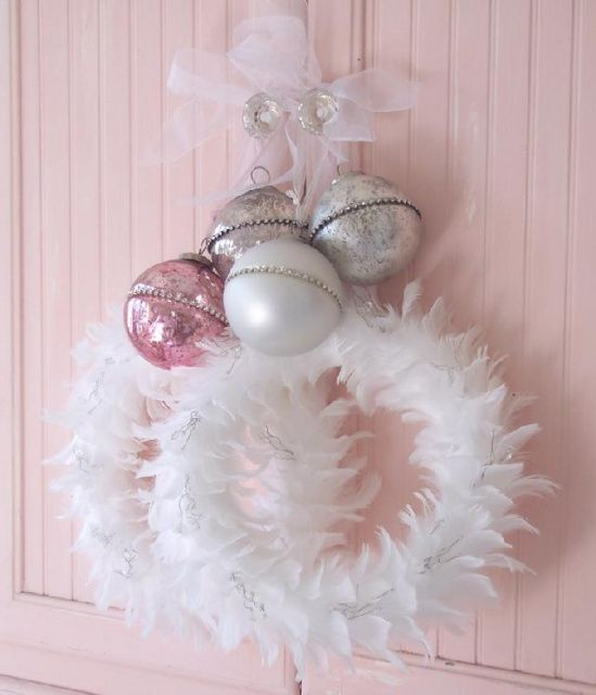 white feather wreath with vintage pastel ornaments