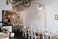 a hanging bike is a cool hipster touch to a coffee shop's interior