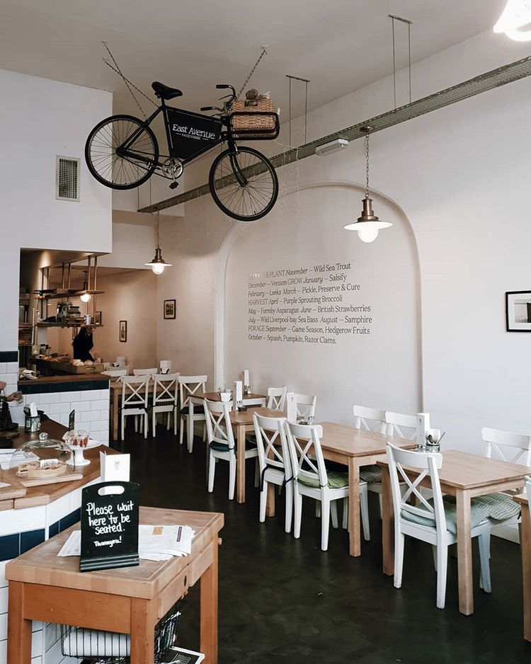 a hanging bike is a cool hipster touch to a coffee shop's interior (via @lewisombler)