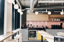 mixing industrial vent system with retro colors and elements works well for coffee shop interiors