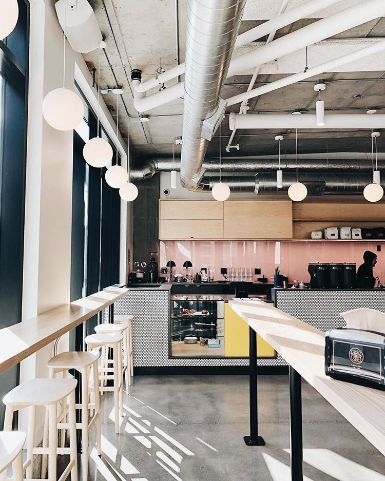 mixing industrial vent system with retro colors and elements works well for coffee shop interiors (via @marshallsteeves)