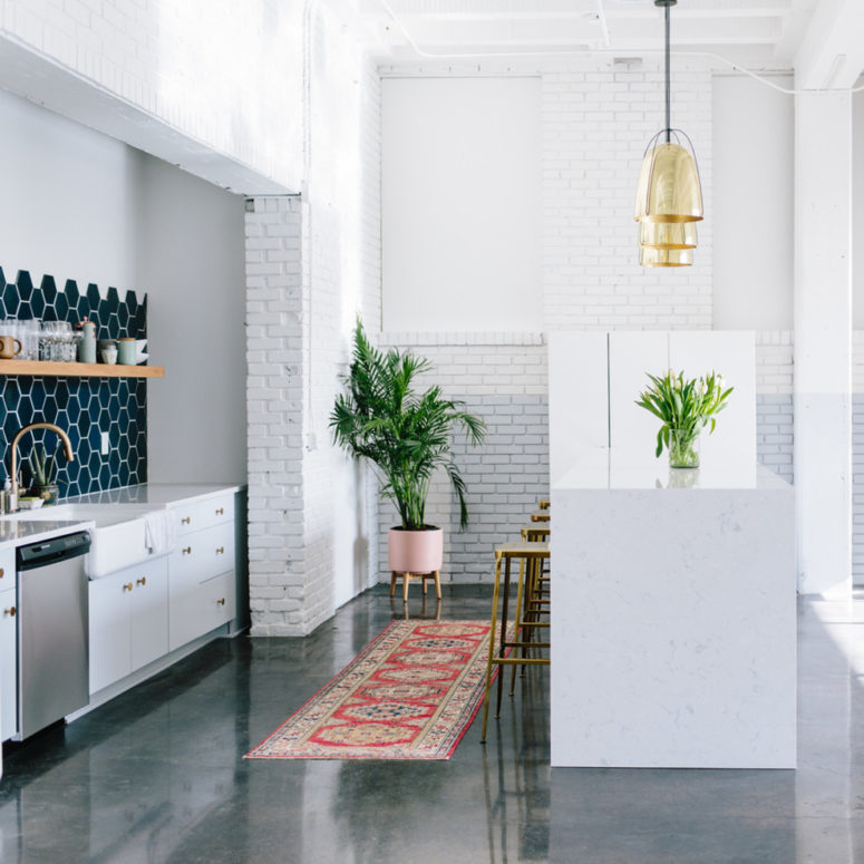 a navy hexagonal tile backlash is a highlight of this minimalist kitchen (Cambria)