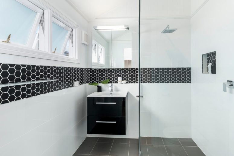 black hex tiles with white grout create unique highlights to niches in plain white walls (Designtank)