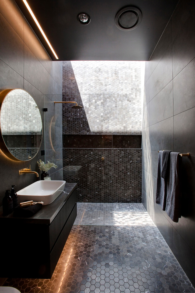This Moody Dark Bathroom Features Lots Of Tiles Shades To Highlight Its Floor And A Shower