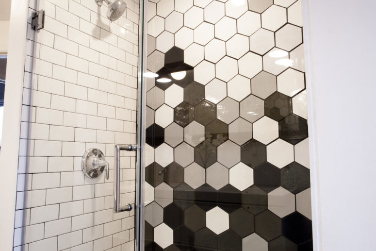 several shades of hexagonal wall tiles allows to create an unique graduation on the shower wall (Mercury Mosaics and Tile)
