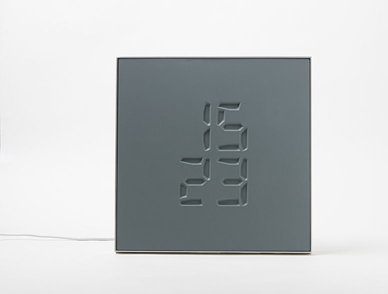 Etch clock engraves time on its surface