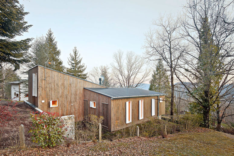 Pine clad was widely used outside and inside the cottage to highlight that it's a forest home