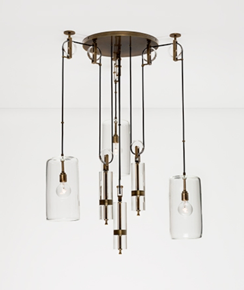 The chandelier is a cool industrial piece of glass and metal, its a little asymmetrical design catches an eye
