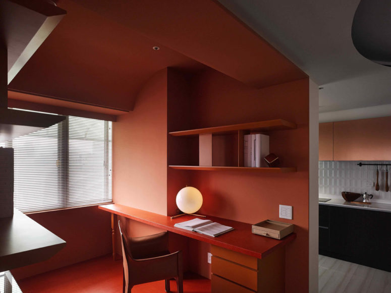 The layout is open though the apartment is separated into zones with colors and in other ways