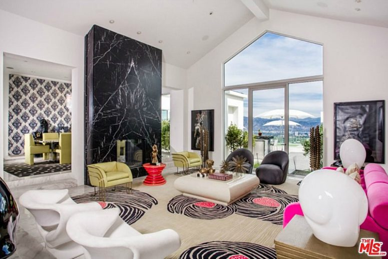 The living room features architectural furniture, bold accents and various patterns