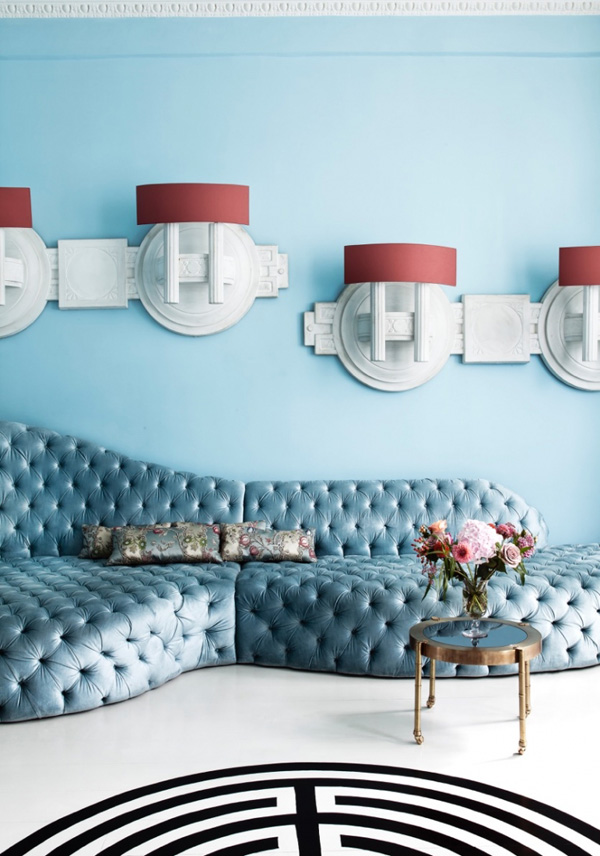 The serenity blue diamonf upholstery sofa is the focal point of the living room