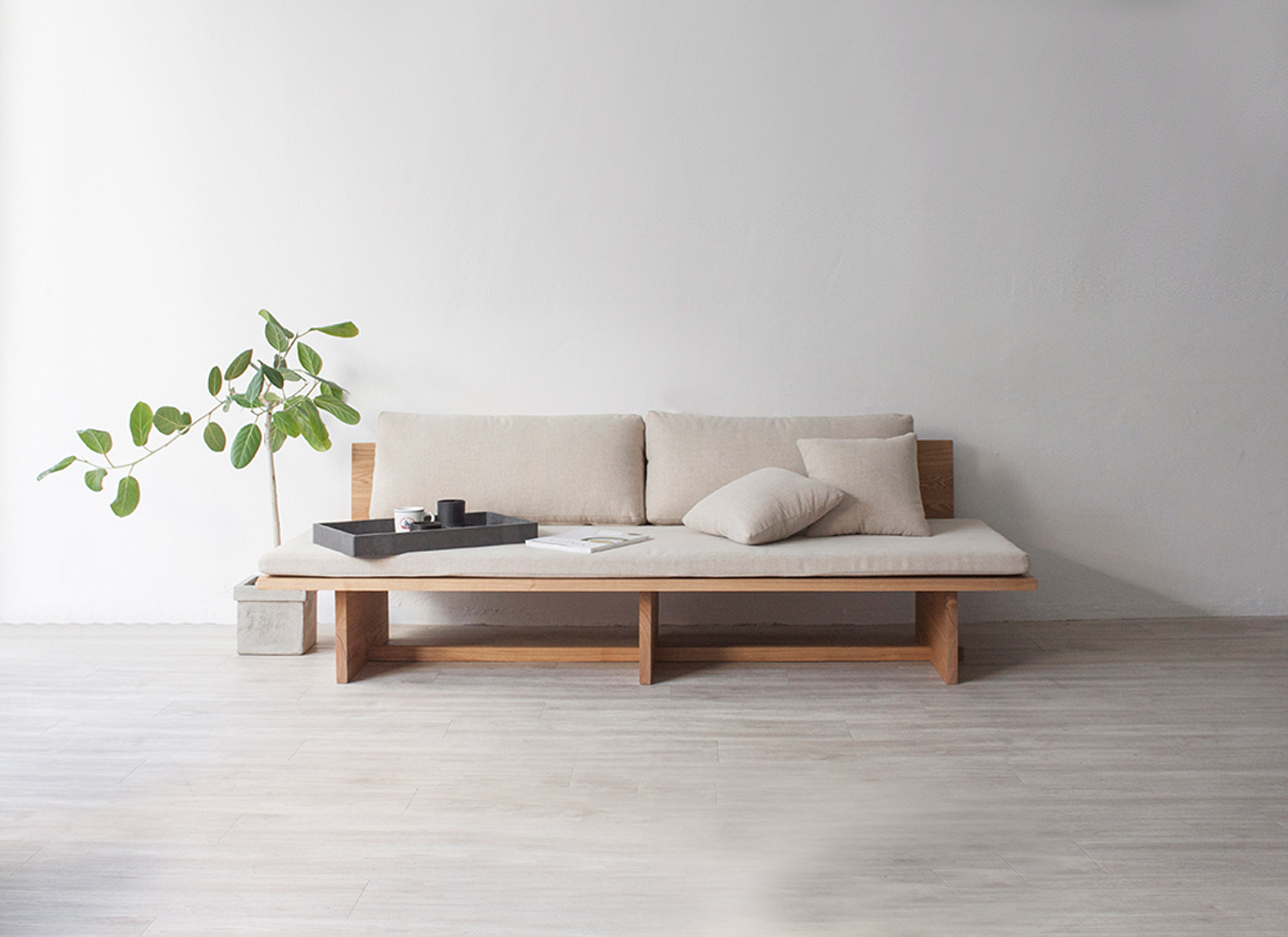 The sofa is made of wood and soft cushions, which are removable if you want to clean them
