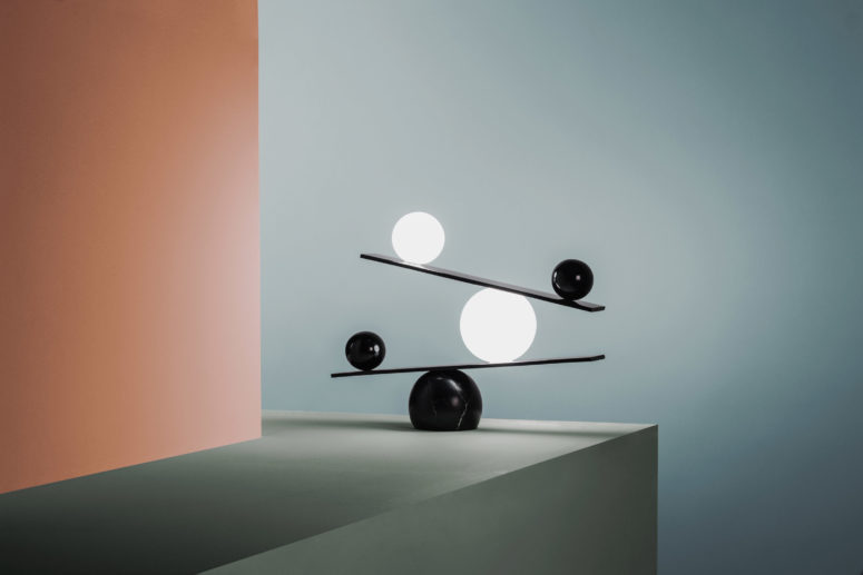 These are monochrome orb lamps put on angular shelves, all the wires hidden