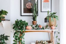 02 various greenery and ficuses in cute wooden and woven pots refresh the interior