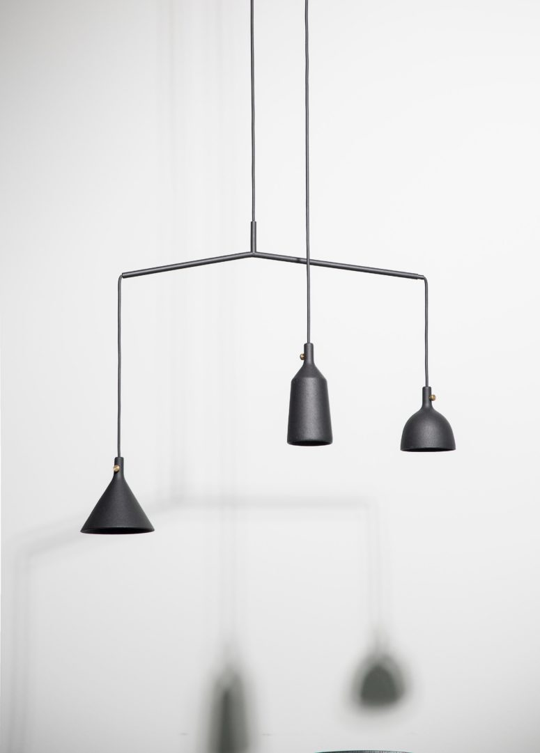 This lamp has an eye-catchy asymmetrical design and comes in timeless black