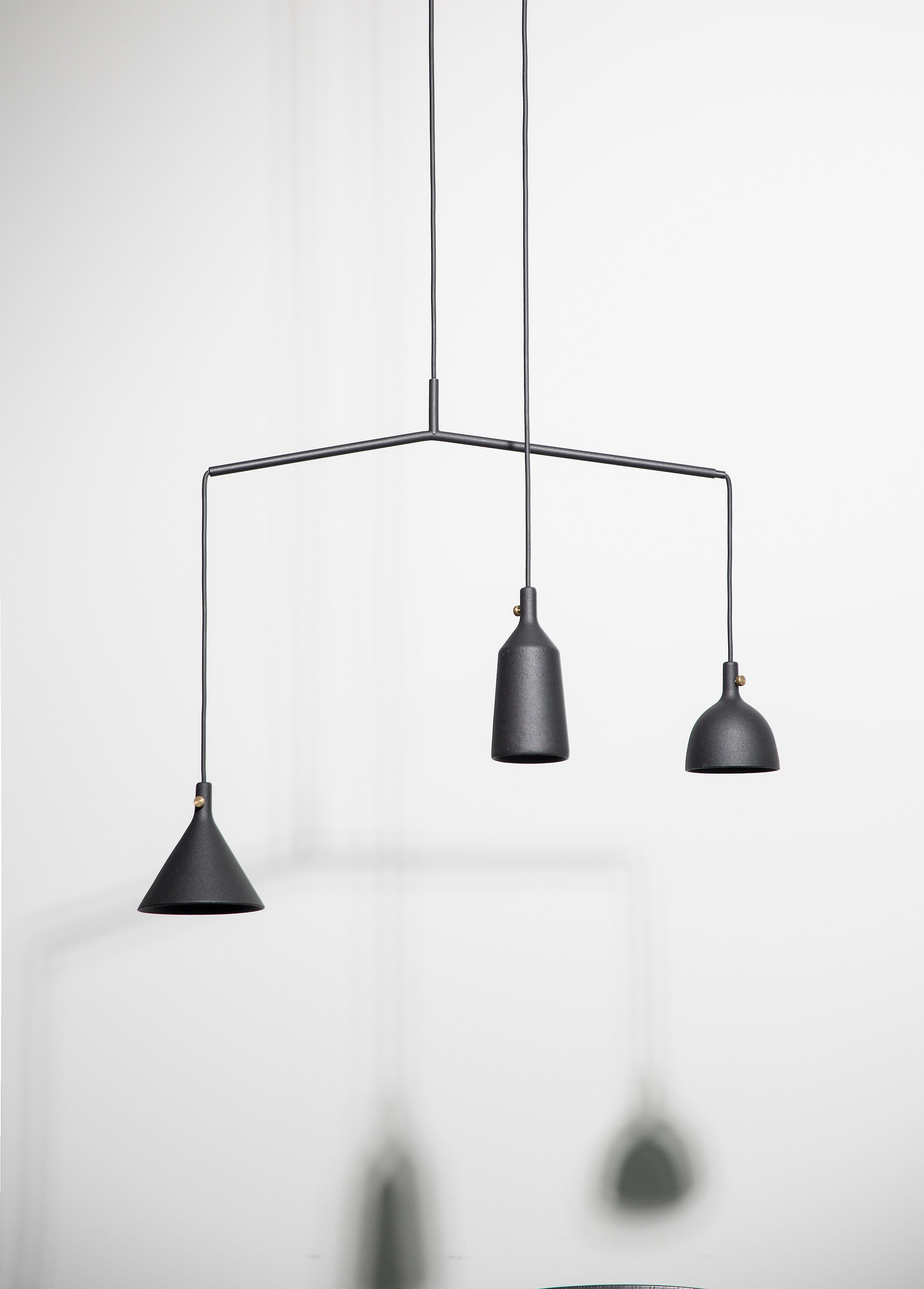 This lamp has an eye catchy asymmetrical design and comes in timeless black