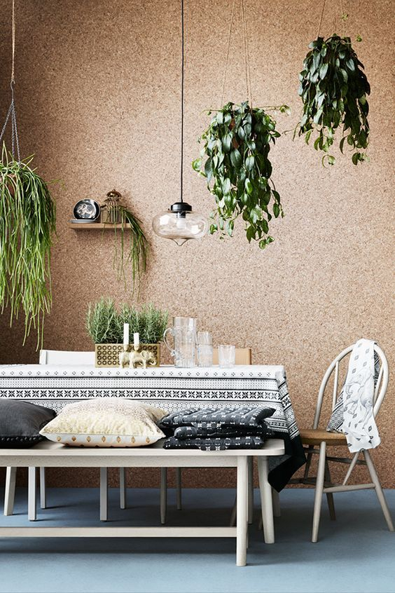 a cork covered wall looks cool and textural, besides it's great for sound-proofing