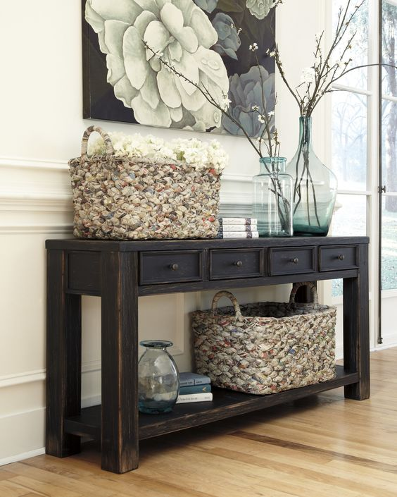 dark rustic console table with drawers and a shelf