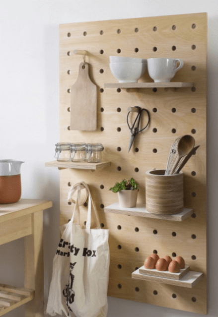 light-colored wooden pegboard with shelves will fit a modern or minimalist kitchen