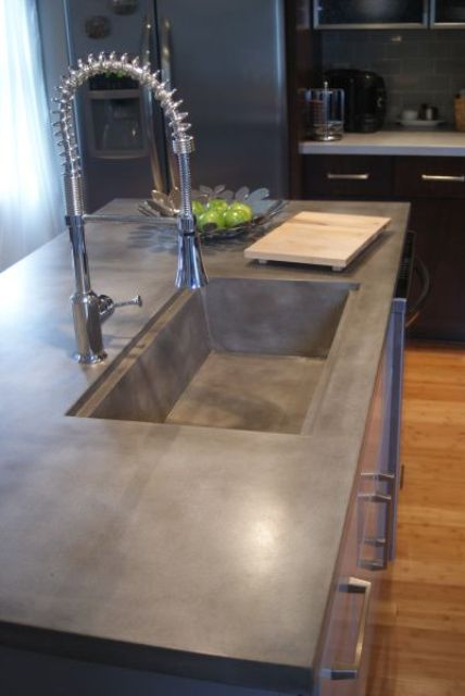 sink and countertop of a piece of concrete for the kitchen