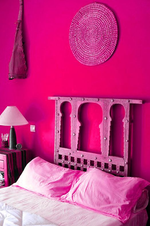 vibrant Morocco-inspired bedroom with hot pink walls and all the rest pink