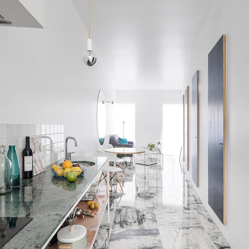 The kitchen is a simple open space wwith marble and stone surfaces as such a look is more airy