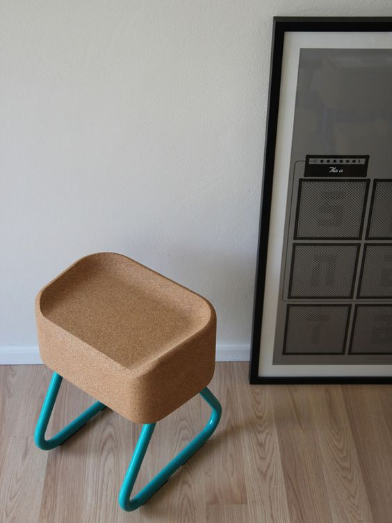 a cork seat and bold turquoise framing contrast to create a modern flavor