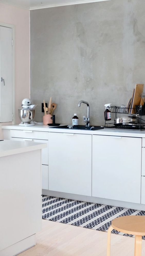 concrete walls and backsplashes in the kitchen is a practical solution