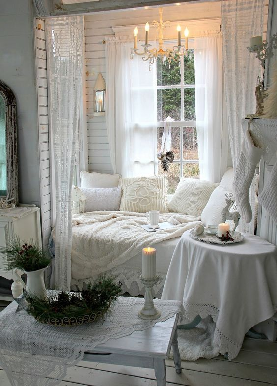 shabby chic all white window nook with soft pillows