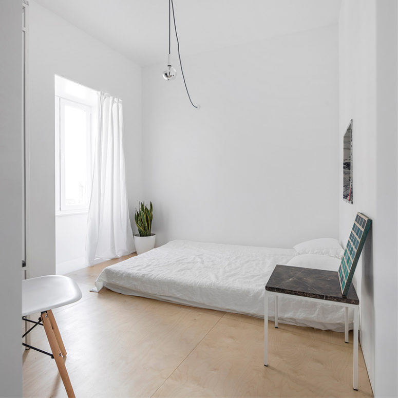 Bedrooms' existing small sizes are visually expanded with the use of light colors and few furnitures