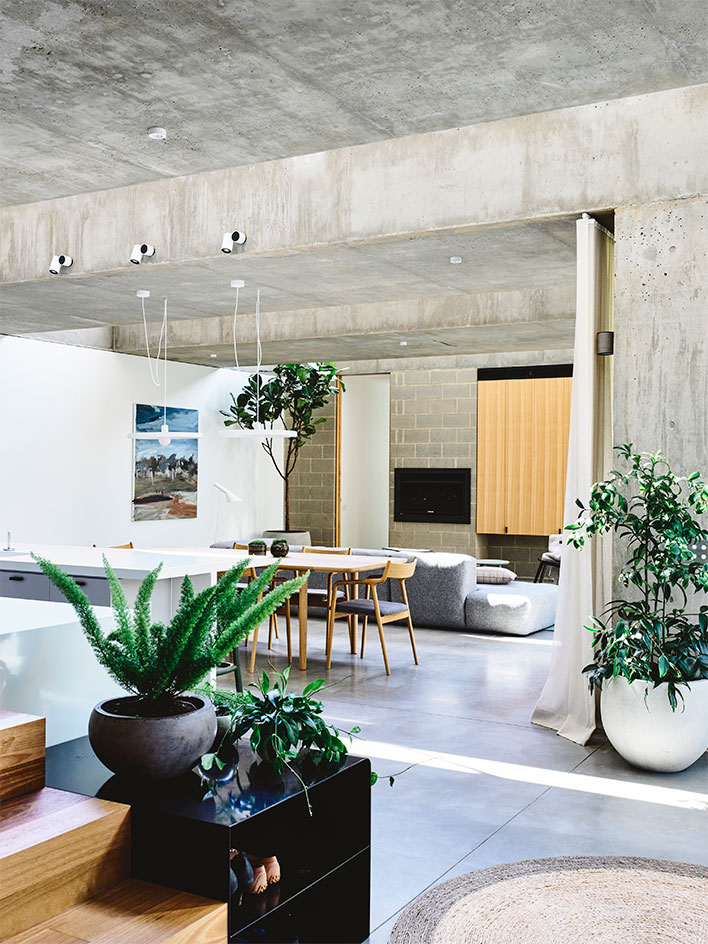 Despite of the extensive use of concrete, the interiors are very cozy