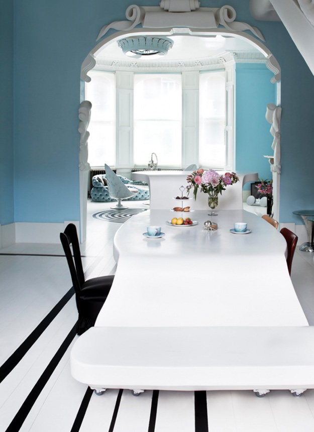 Look at this dining space, it's a bit surrealistic with a table flowing down