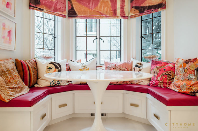 This is a breakfast nook done in hot pink and other bold colors