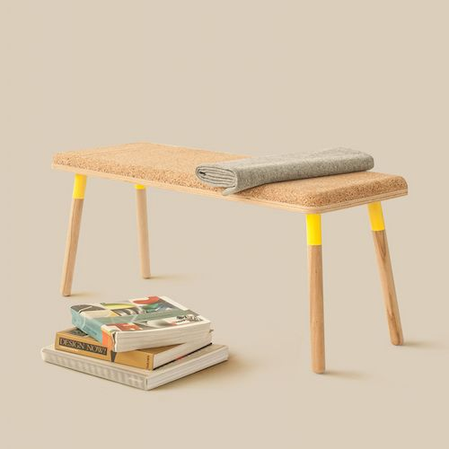 A Cork Seat And Wooden Legs With A Neon Yellow Accent