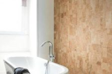 05 a cork wall looks textural and chic while being budget-friendly