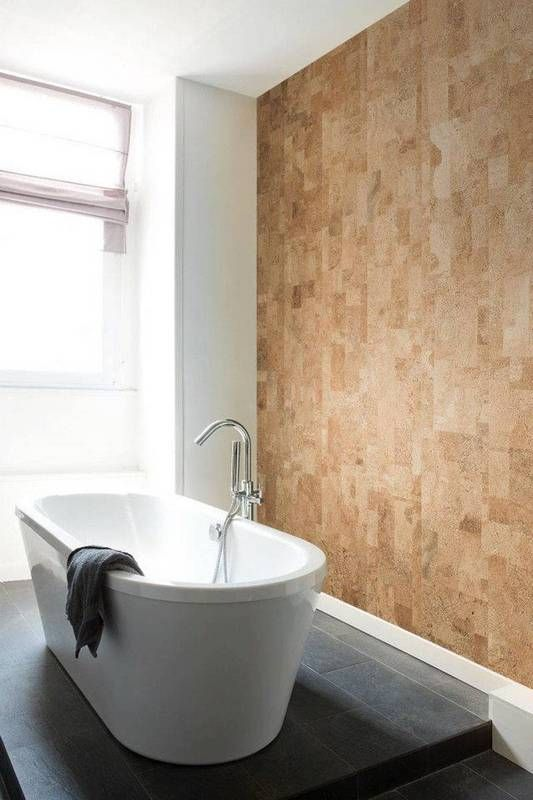 a cork wall looks textural and chic while being budget-friendly