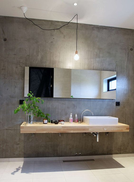 Concrete Walls Give This Bathroom A Modern And A Bit Industrial Look