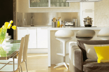 05 every space is separated with its furniture – sofas, tables and a kitchen island