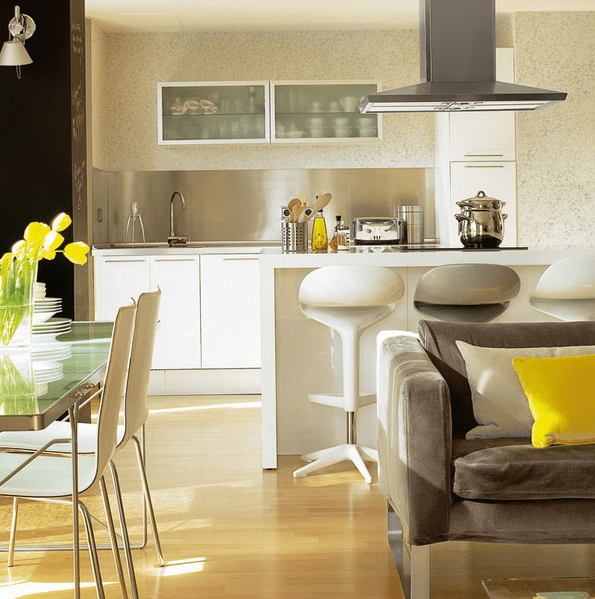 every space is separated with its furniture - sofas, tables and a kitchen island
