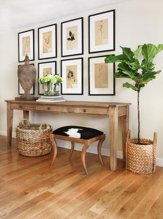 long and narrow light wood console table with drawers