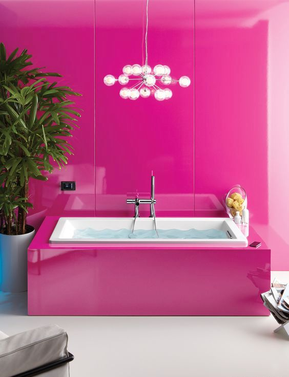 modern girl's bathroom, walls and the bathtub covered with fuchsia panels