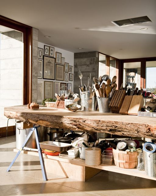 open kitchen layout with a large rough wood edge island that accomodates everything