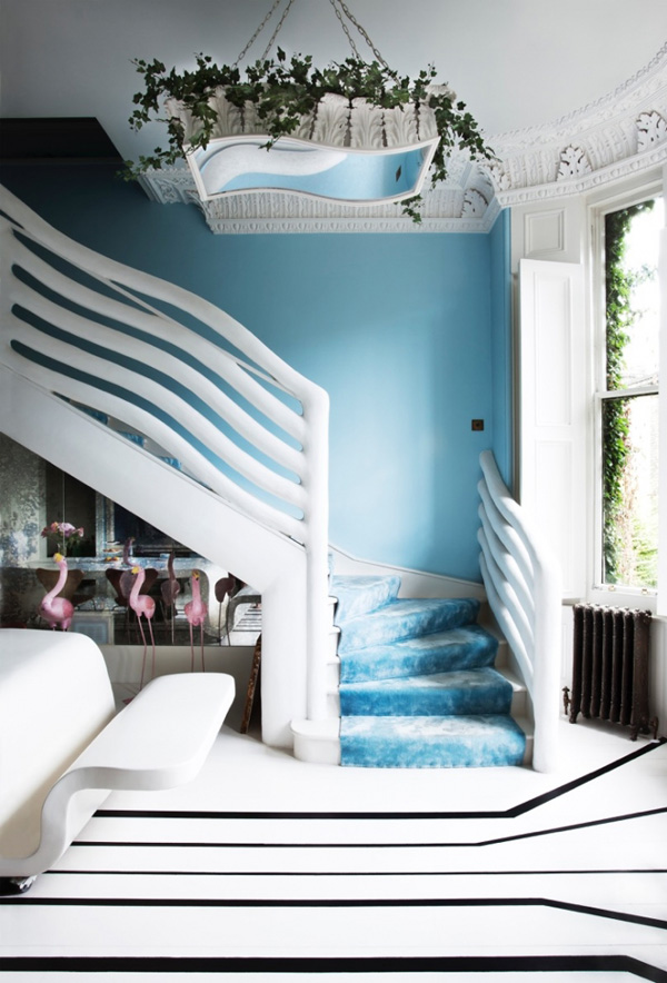 The whole apartment is done in that subtle blue shade, black and white are added for a contrast